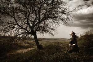 Woman-kneeling-under-tree-300x200